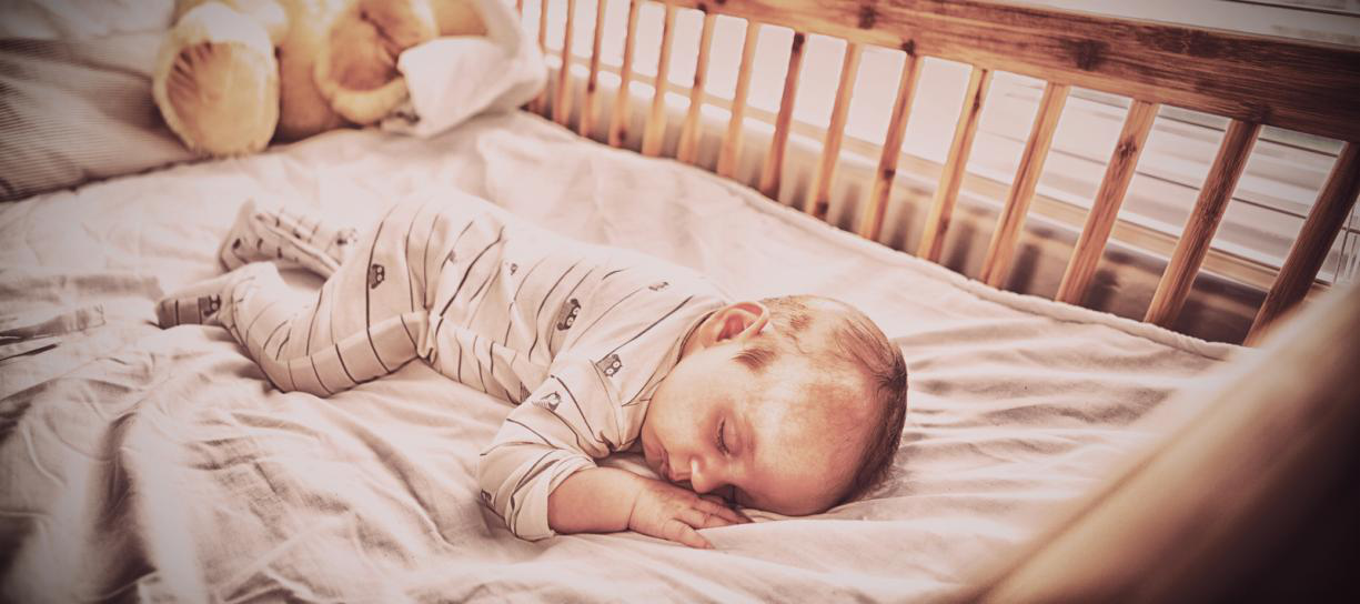 A baby sleeping peacefully in the cradle