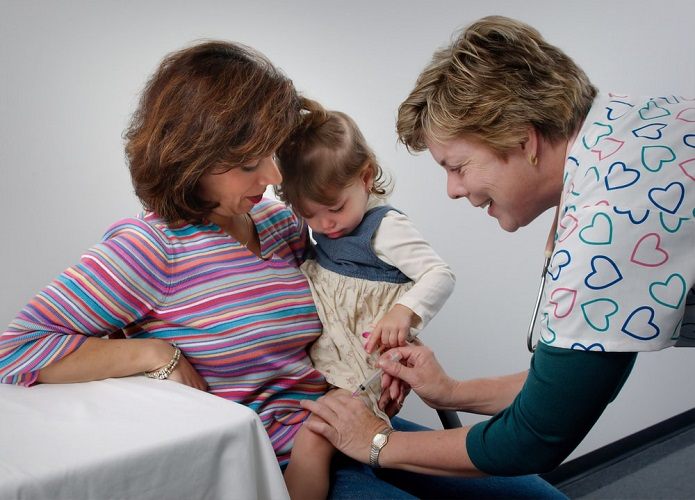 A child getting vaccinated at a pediatric clinic