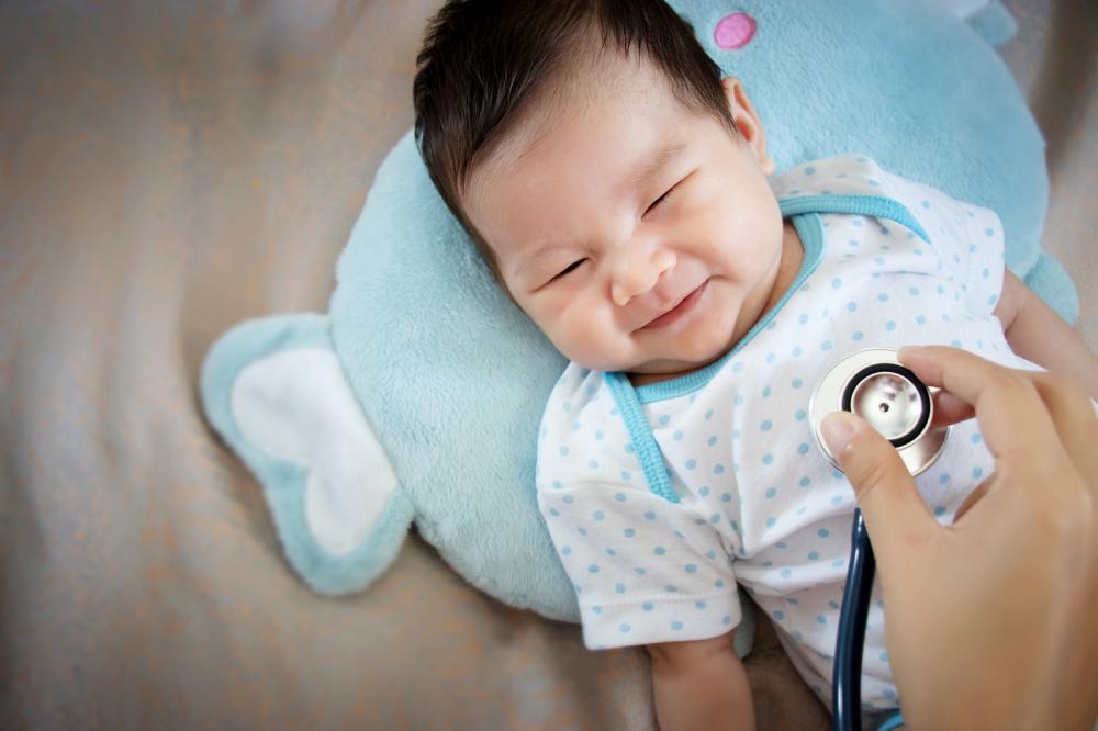 A newborn baby going through a routine checkup at a pediatrician clinic in San Antonio.