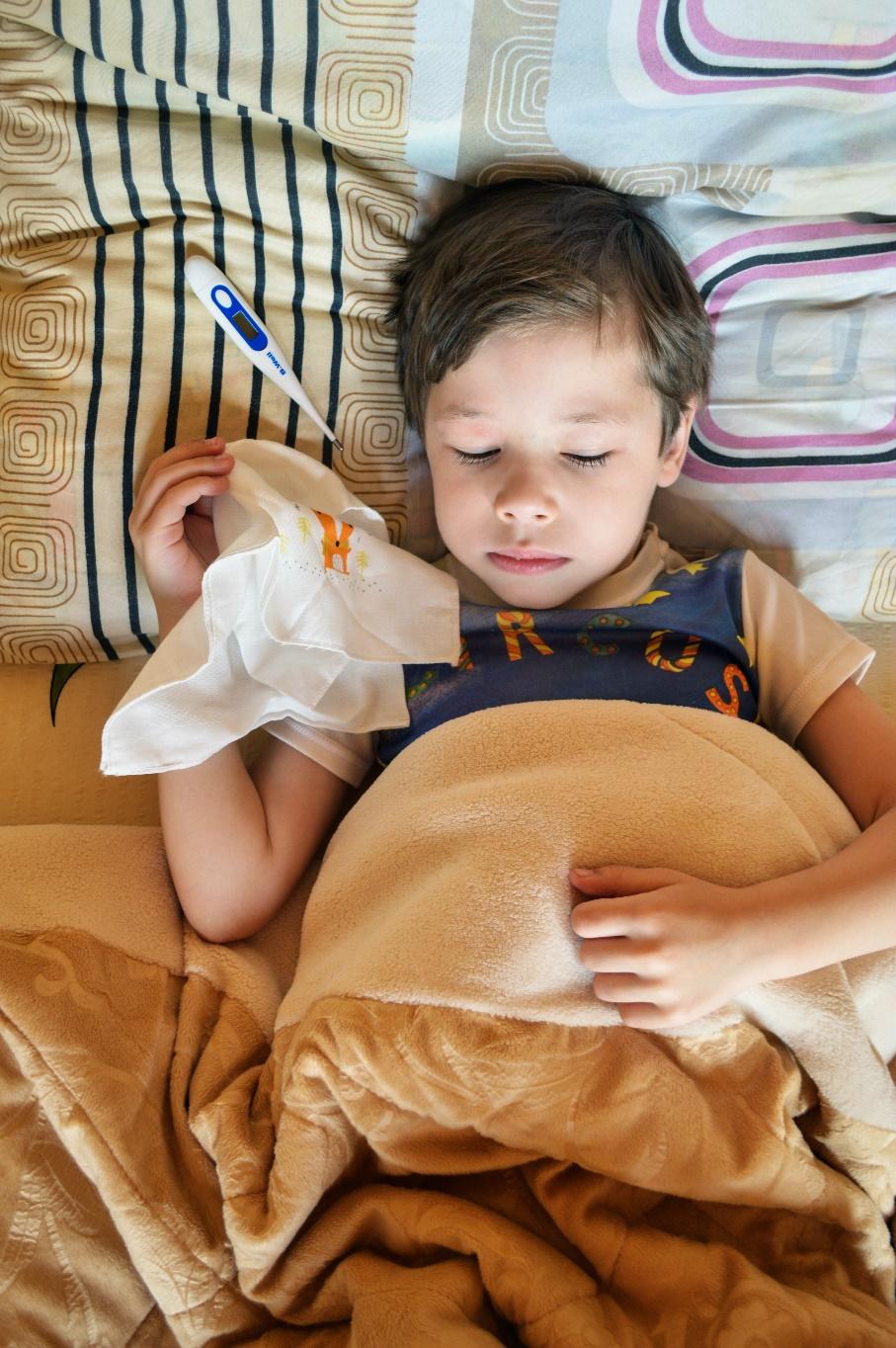 A sick boy lying in bed